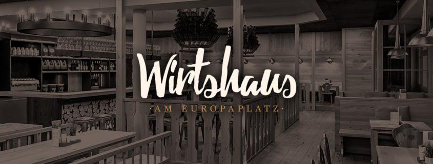Wirtshaus-Logo auf abgedunkeltem Hintergrund mit Innenausstattung